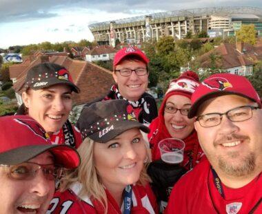 group of Birdgang members selfie outside stadium