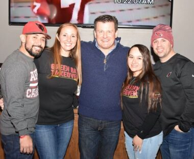 Fans posing for photo with Cardinals