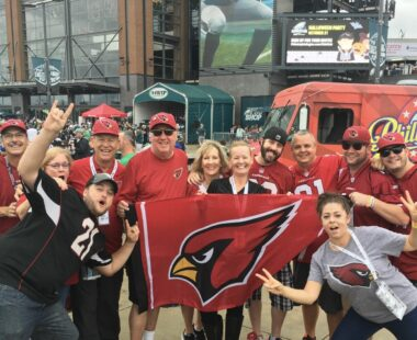 Excited Birdgang Members with Banner