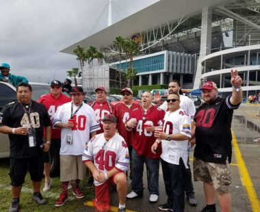 Cardinals fans posing outside stadium